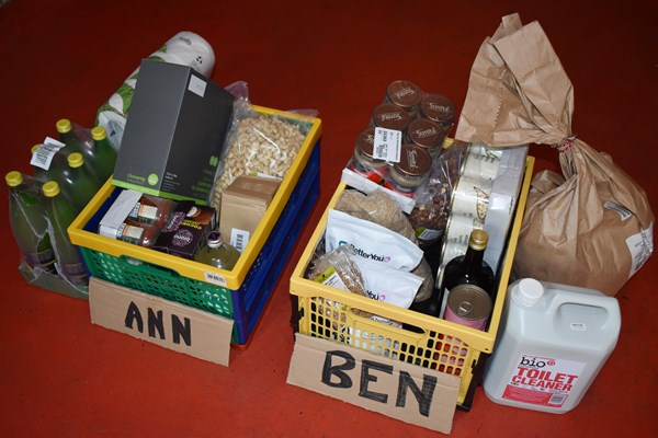 Crates of food labelled with members' names